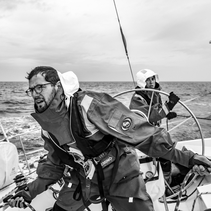 Reportage photo by France-based photographer Alex Buisse of people on a boat