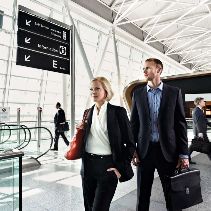 Lifestyle photo by Zurich, Switzerland based photographer Daniel Hager of  a couple walking in an airport.