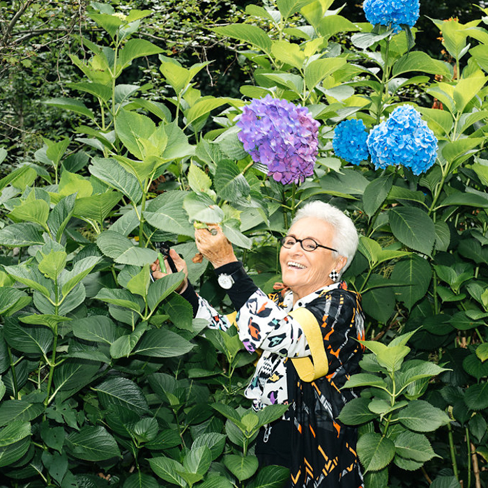 Reportage photo by Milan-based photographer Federico Ciame of an old woman tending to her garden.
