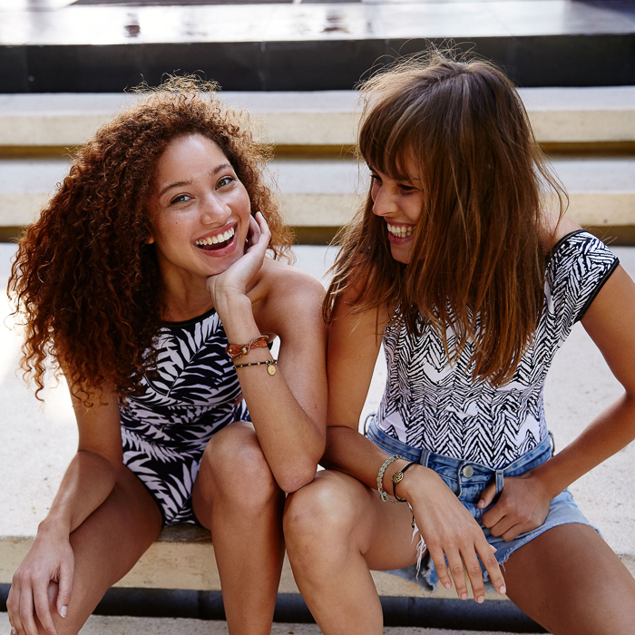 Lifestyle photo by Brooklyn, New York-based photographer Janelle Bendycki of two women sitting together.