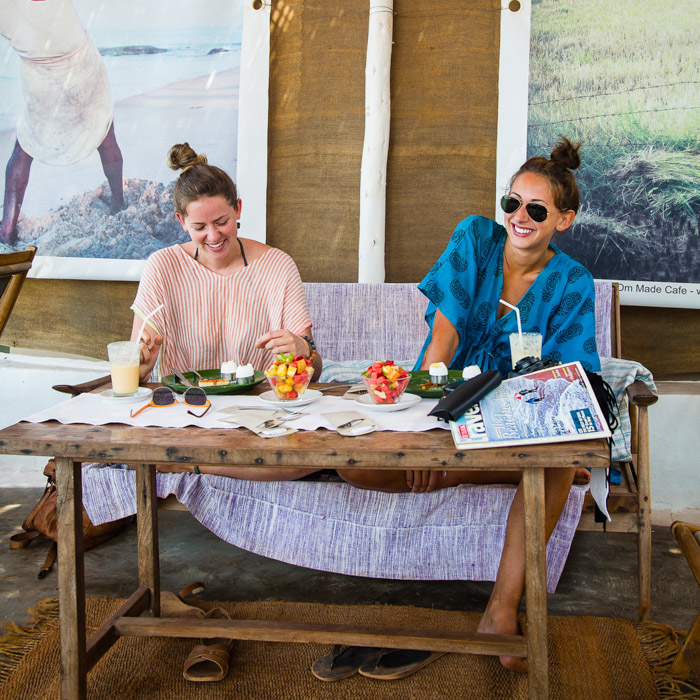 Travel photo by Tel Aviv, Israel-based photographer Yadid Levy of two women eating at a cafe in India.