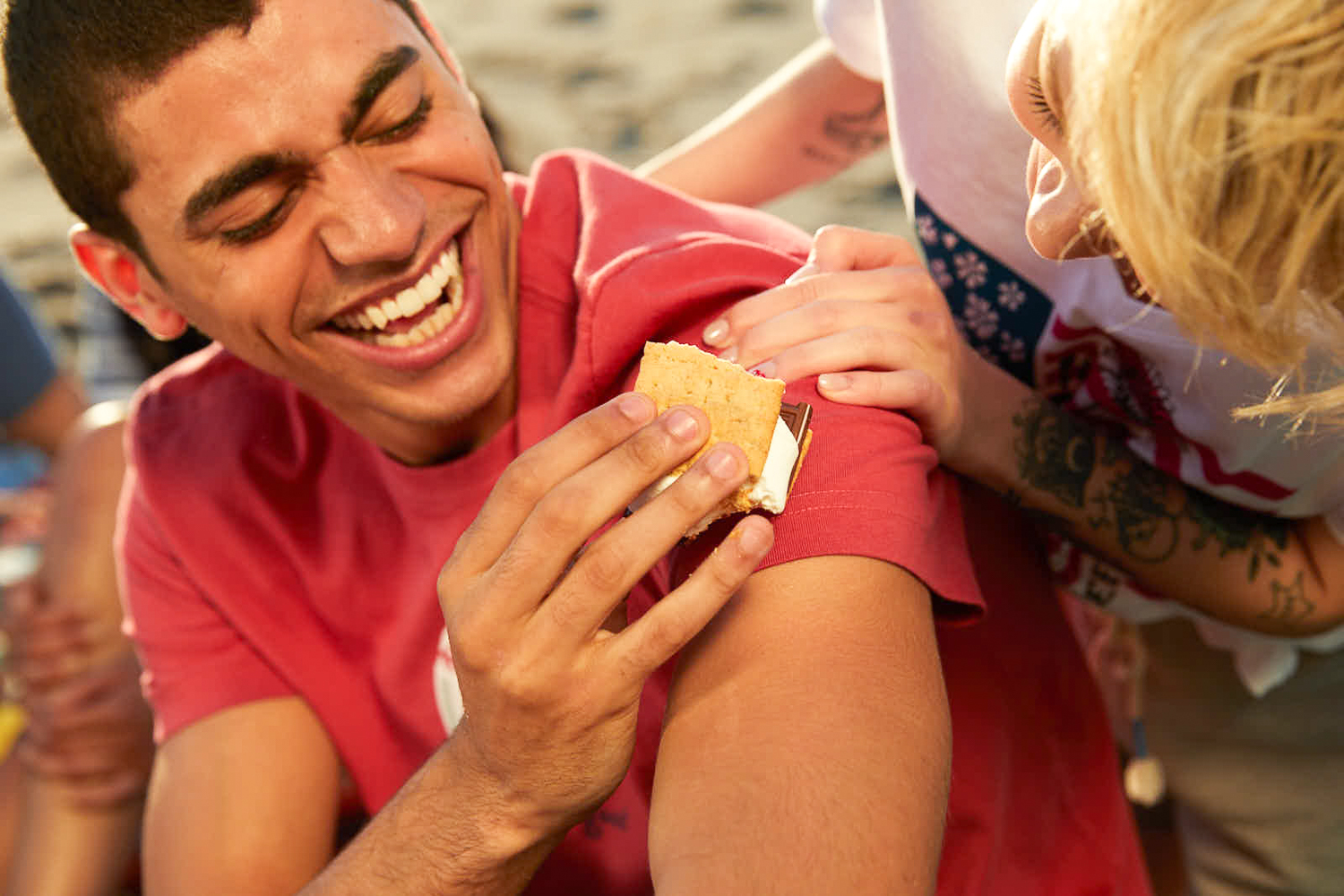 Image of two young people on a beach by Bryan Sheffield for the Life is Good clothing company