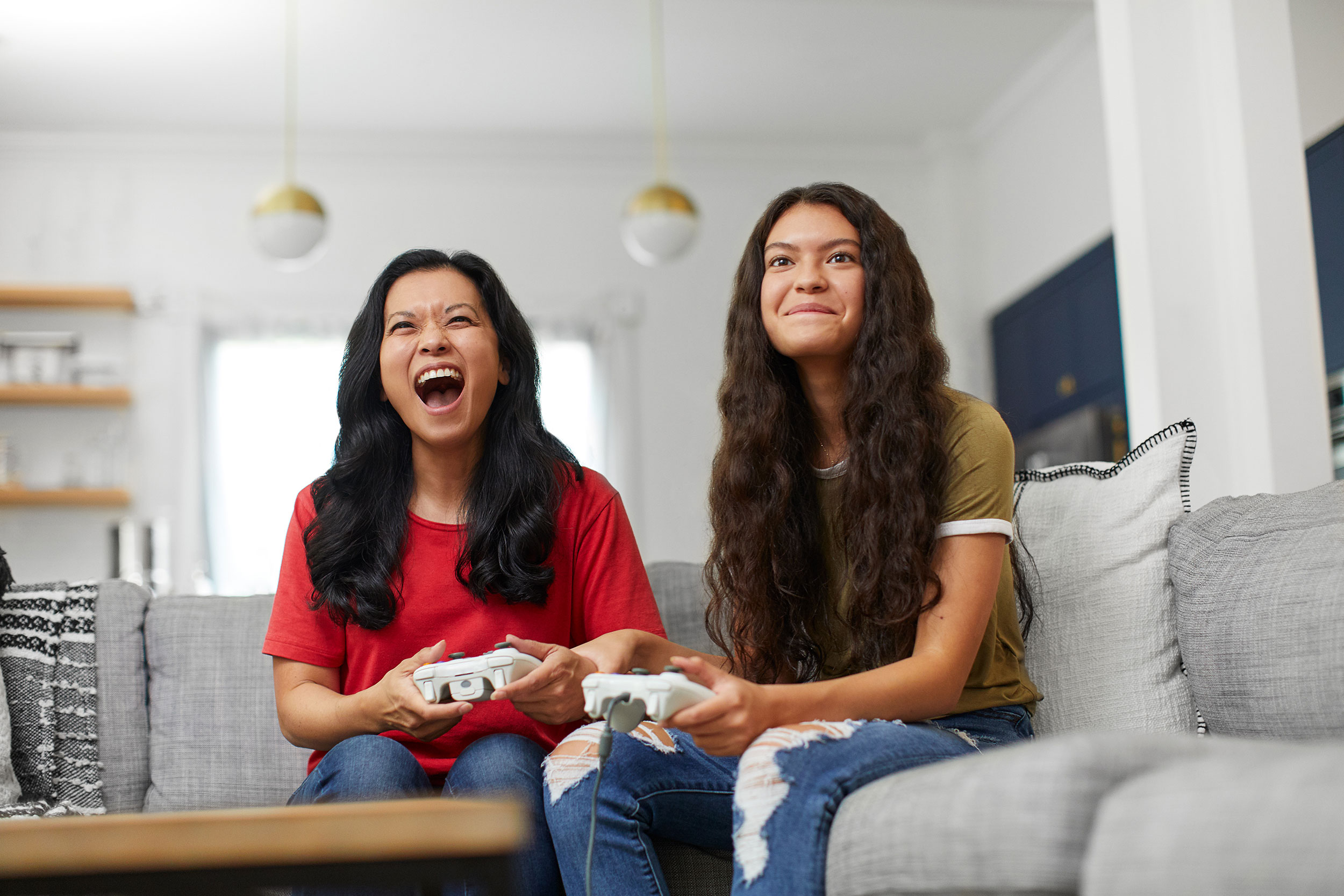Natalia Weedy Calix two young women playing a console video game