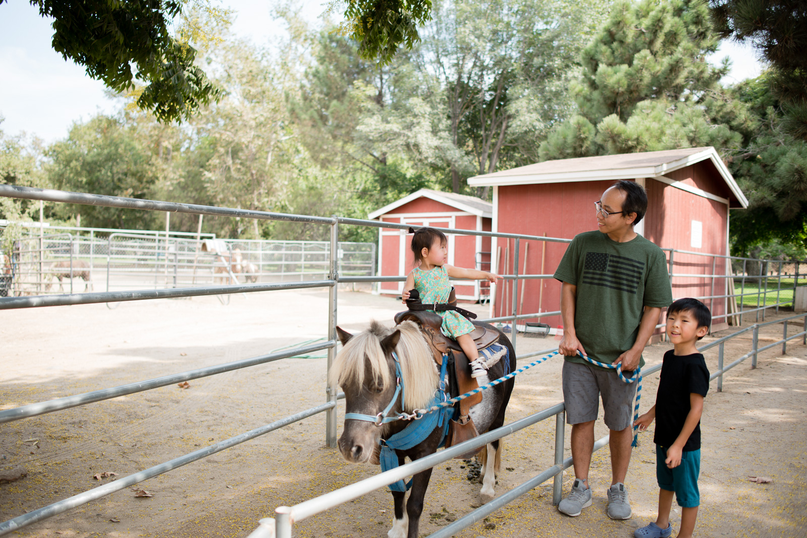 Tiffany Luong photographs children and husband riding ponies for Westways